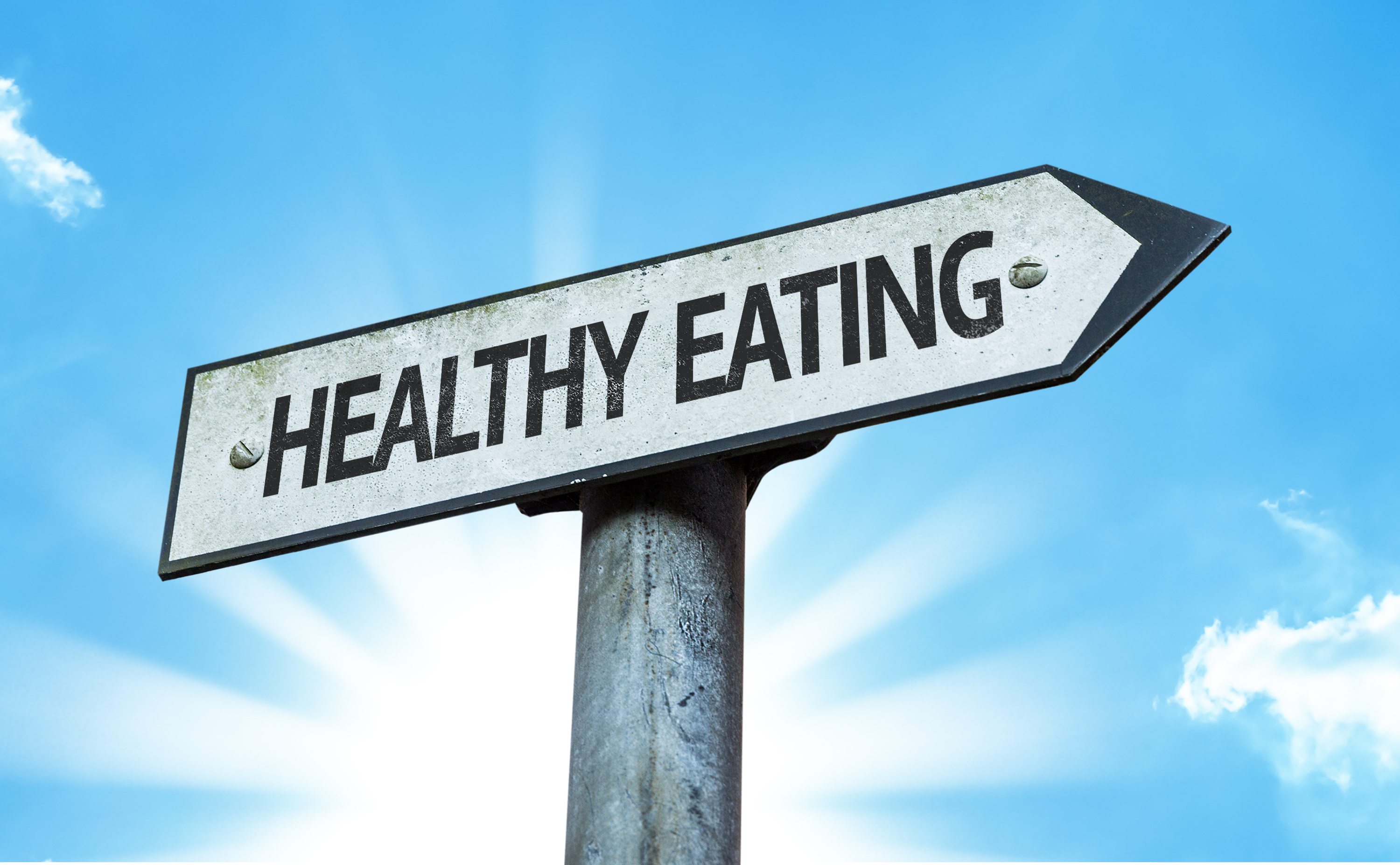 Healthy Eating sign with a beautiful day